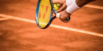 Detailed shot of a man serves at tennis game